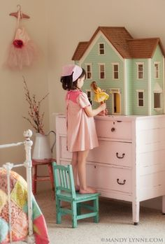 Cute, cute, cute room!! like the colors of the quilt even though it's hard to see. Vintage girls room