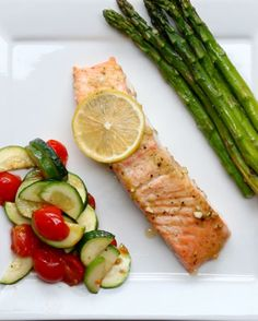 One-Pan Lemon Pepper Salmon - 4 salmon fillets 1 tablespoon lemon juice 2 tablespoons olive oil 2 cloves garlic, minced Salt & Pepper to taste 1 teaspoon dijon mustard 1 pound asparagus 2 zucchinis, sliced 12 cherry tomatoes, halved Olive oil Salmon Recipes, Fish Recipes, Seafood Recipes, Cooking Recipes, Healthy Recipes, Lemon Pepper Salmon, Salmon And Asparagus, One Pot Meals, Easy Meals