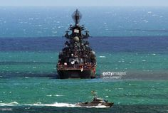 A Venezuelan Coast Guard patrol boat sails near Russian nuclear-powered missile cruiser Pyotr Veliky (Peter the Great), at anchor in front of the port of La Guaira, 30 km from Caracas, on November 25, 2008. A Russian naval squadron led by Northern Fleet's flagship Pyotr Veliky arrived in Venezuela to conduct a joint exercise with the Venezuelan Navy, as agreed on July 2008, when Venezuelan President Hugo Chavez visited Moscow. AFP PHOTO/Juan BARRETO