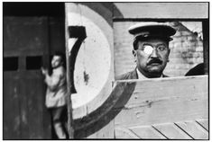 Henri Cartier-Bresson SPAIN. Valencia. 1933. Inside the sliding doors of the bullfight arena.