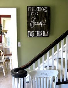 <3 sign and <3 wall color next to white molding
