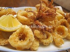 When you're hungry (especially during Lent) your belly can inspire you to create the simplest and most delicious dishes. One of the easiest dishes to prepare is fried calamari. One need only find fresh or thawed from frozen squid, mix a bowl of. Calamari Recipes, Squid Recipes, Fish Recipes, Seafood Recipes, Cooking Recipes, Greek Dishes, Fish Dishes, Seafood Dishes, Fish And Seafood