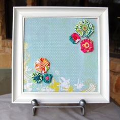Make your own customized magnet board with an old frame, scrapbook paper and magnetic paint.