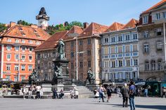 Graz Hauptplatz with statues, coloured buildings and a view to the clock tower Austria Country, Graz Austria, Street Pictures, Heart Of Europe, Austria Travel, Statues, Traveling By Yourself, Buildings, Places To Visit