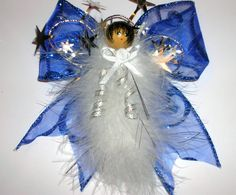 This angel has a soft white marabou feather body flecked with silver threads and the wings are made of an electric blue shimmery wired ribbon.