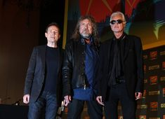Robert Plant Photos - (L-R) John Paul Jones, Robert Plant and Jimmy Page of Led Zeppelin attend a press conference to announce Led Zeppelin's new live DVD Celebration day at 8 Northumberland Avenue on September 21, 2012 in London, England. - Led Zeppelin - Press Conference