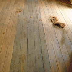 Hand-scraping old wood floors is much gentler on them and preserves them better than floor sanders.