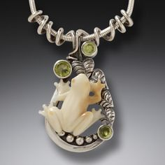 This silver frog necklace in ancient fossilized walrus ivory and green peridot is the perfect piece for any lover of silver frog jewelry thanks to its natural charm. •Fossilized walrus ivory tree frog