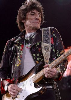 Ronnie Wood Shreds Guitar with the Rolling Stones.  http://www.musicalbiography.com/ronnie_wood.htm