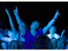 A woman sings during the Women of Faith conference Saturday at the Honda Center in Anaheim.