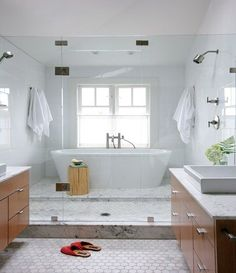 Looking for creative bathroom designs to take a 1970's sunken shower to a modern, beautiful design!