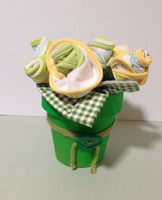 This beautiful baby pot contains 9 bibs and 1 receiving blanket. Its available in pink and green and is a useful gift for expecting parents.