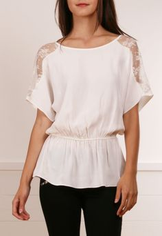 Love the silhouette of the flawy top with the structured pant. Lace detail on the top adds interest through texture