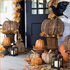 Vine woven, stone, and real pumpkins, paired with a single raven and a couple beautiful lanterns create a festive fall vibe at this home's front door. Celebrate the pumpkin and all that it has to offer here: http://www.pumpkinmasters.com/index.asp.
