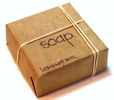 An image of a bar of soap packaged in brown paper with string.