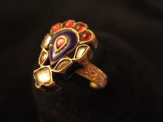 """This old ring typically Moghul shows all the refinement of the """"orphèvres of tradition"""" who are still very present in great metropolitan centers like Jaipur or Delhi. 20ct gold, diamonds, glass, enamel, India"""