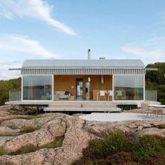 Summer house on stilts by Mats Fahlander  nestles into the landscape of a Swedish fjord