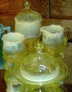 Vaseline glass, America, Unattributed, opalescent Wreath and Shell, four piece table set, covered sugar, creamer, covered butter dish and an open sugar. Very rare set.