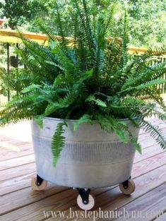 repurposed galvanized tub into a planter on wheels
