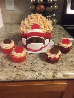 Sock monkey smash cake and button cupcakes