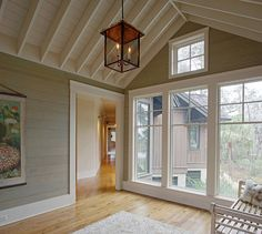 The shiplap walls were painted in Benjamin Moore Bone White. Johnny Ruxton, a local faux painter and artist, applied an antiquing glaze over them to add some gray and brown tint to it. could add pink undertones to it Room Additions, Rustic Cottage, Floor To Ceiling Windows, Open Ceiling, White Ceiling, Ship Lap Walls, Reno, Luxury Interior Design, Architecture