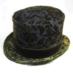 """Strut your festival style wherever you go in this Sexy Steampunk Top Hat! This Magicians Circus Hat is 5"""" tall and would fit a small to medium-sized head. Under the brim you will find a hand-woven raf"""