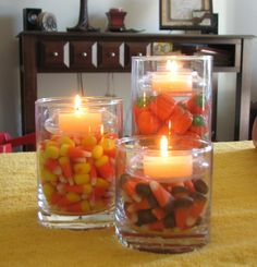 Floating Candle Trio - fun ideas of how to switch things up from holiday to holiday. For Christmas, use peppermints and pinecones! For Easter, use jelly beans or Peeps!