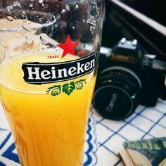I'm having my #orangejuice in a #heineken glass.  #fruit #camera