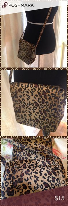 """Cross My Heart"" crossbody purse!! Perfect animal print crossbody by Nine West. The outside flap snaps shut. Purse has a pocket under the flap as well as a zippered pocket inside. 8 inches wide by 7 inches tall with a handle drop of 23 inches. Grrrr!! Nine West Bags Crossbody Bags"