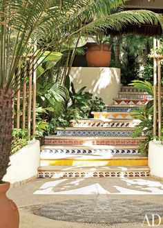 Mexican tiles brighten the guesthouse stair of a Punta Mita home decorated by Martyn Lawrence Bullard.