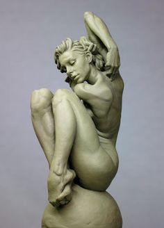 Eric Michael Wilson - female sculpture - seated - arm up and legs crossed