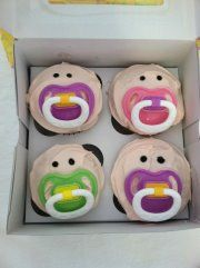 BABY FACE CUPCAKES!  What an adorable way to gift pacifiers to a new mom-to-be!!  (courtesy of Karen Wendland)