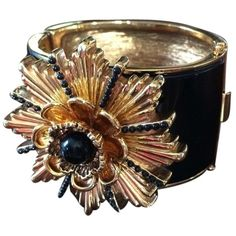 Pre-owned Chanel Style Starburst Cuff Black Enamel And 18kt Gold... (885 CAD) ❤ liked on Polyvore featuring jewelry, bracelets, accessories, black enamel and gold plate, flower cuff bracelet, hinged cuff bracelet, cuff bracelet, gold plated jewelry and cuff bangle bracelet