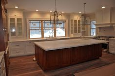 Calacatta marble counters and LOVE the light fixtures.  Dream kitchen!