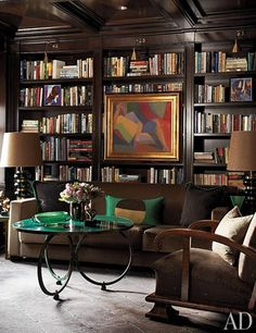 A dark and traditional library with modern accents | archdigest.com