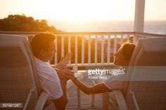 Stock Photo : Couple holding hands at sunset