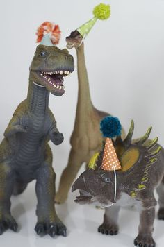 Why not make little party hats & use a few dinosaurs as party decor.