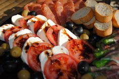Antipasto platters are great for any time you need an easy and delicious appetizer.  Antipasto platters are usually made up of bite-size meats, cheeses and veggies.  In other words, they are full of yum.