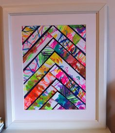 Toddlers Art transformed! Simple Ikea frame, Art work cut into strips and arranged into pattern. Voila! Masterpiece for her bedroom!