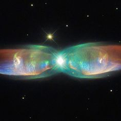 This cosmic butterfly seen by the Hubble Space Telescope is called the Twin Jet Nebula. The glowing and expanding shells of gas clearly visible in this image represent the final stages of life for an old star of low to intermediate mass. The star has not only ejected its outer layers, but the exposed remnant core is now illuminating these layers - resulting in a spectacular light show. Details: http://go.nasa.gov/1KvJhwU  Happy #spaceSaturday everyone!  Credit: NASA  #NASA #universe…