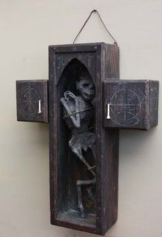 The physical manifestation of a lesser daemon, bound in a wooden cross.         Whatever you do, don't break the glass!