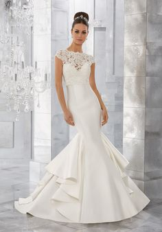 Simple and Chic, This Marcella Satin Sculptured Mermaid Features a Romantic Sweetheart Neckline and Covered Button Detail Along the Back. Shown with Pearl and Diamanté Beaded Alençon Lace Jacket (not inlcuded), Sold Separately as Style #11275. Colors Available: White, Ivory.