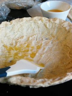 We've been reading a lot of pie recipes lately. In all of their diversity, there are a few common patterns and good tips that have turned up. Our favorite so far is this classic tip: Brush your unbaked crust with beaten egg.