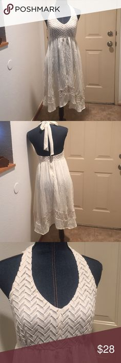 Cream Colored Halter Dress This dress is beautiful with its design on top and on the bottom. See pictures. Flying Tomato Dresses Midi