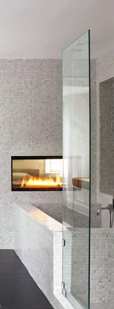 I like this arrangement of the bed-fireplace-tub-shower. I think the windows don't work out to place the bed directly across from the fireplace.