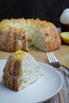 Sweet and sour come together in a perfect pairing with this Gluten Free Lemon Poppy Seed Angel Food Cake. Light and fluffy angel food cake is mixed with the tart flavor of lemon, nutty poppy seeds, and drizzled with a sweet lemon-sugar icing that takes this twist on the classic angel food cake over the top. You'll never even know it's gluten free!