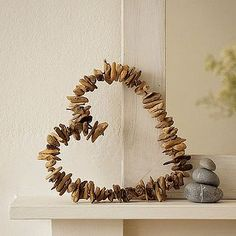 DIY driftwood wreath. ❤  (drill tiny holes and string on heavy wire.)
