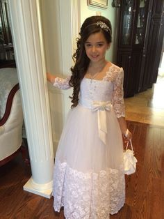 Lace Long Sleeved First Communion Dress for Communion Day. Lace long sleeved First Communion dress for her special Holy day. This stunning girls dress has 3/4 length sleeves with delicate lace overlay