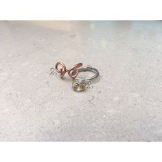 1. Silver citrine ring R70.00    2. Curled copper ring R30.00