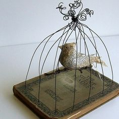 A roll of wire and an interesting old book repurposed into a bird cage. Salvage, upcycle, recycle! Birdcage great for wedding reception or shower decor. For ideas and goods shop at Estate Resale & ReDesign, in Bonita Springs, FL